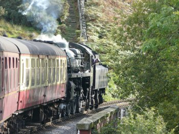 North Yorkshire Moors Railway steam train in countryside near Goathland